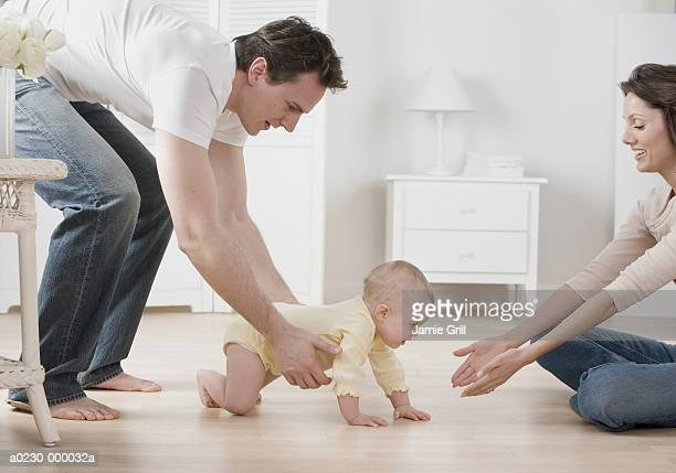 parents with baby - bent over babes stock pictures, royalty-free photos & images