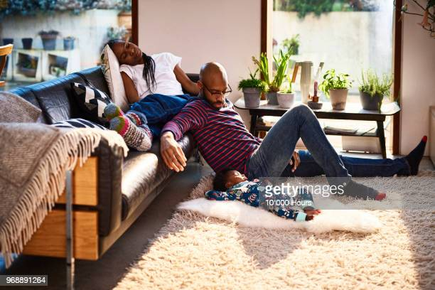 parents with baby son resting - cosy stock pictures, royalty-free photos & images