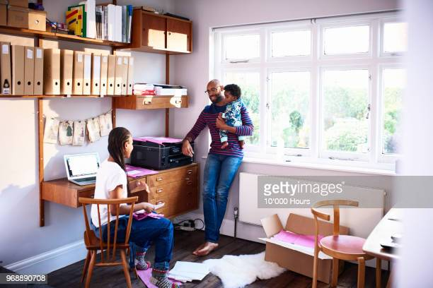 Parents with baby son working at home