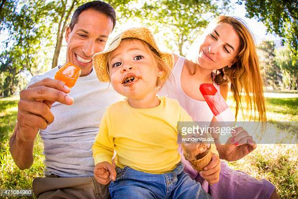Parents with cute toddler with a messy ice cream face