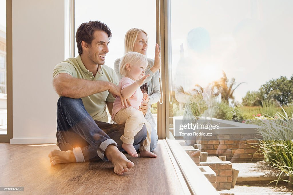 Parents with daughter (12-23 months) at home : Foto stock