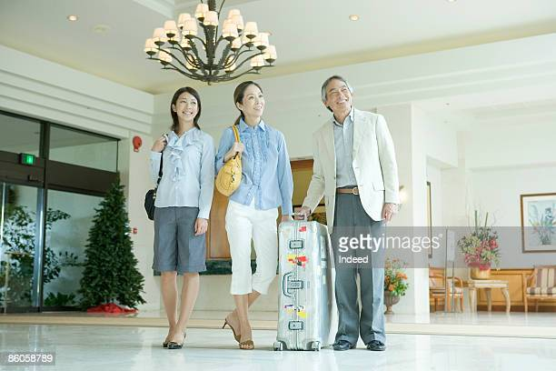 Parents with daughter smiling in hotel lobby