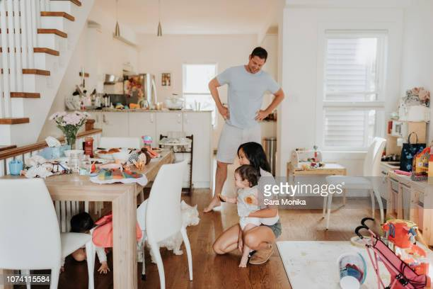 parents with daughters at home - monogamous animal behavior stock photos and pictures