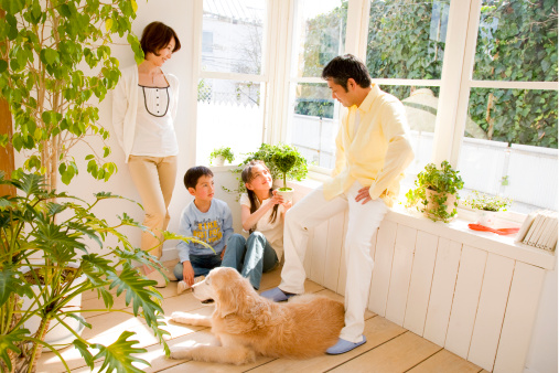Parents with girl and boy (8-10) talking in room with dog - gettyimageskorea