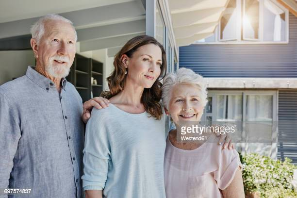 parents with grown up daughter, portrait - contemplation couple stock pictures, royalty-free photos & images