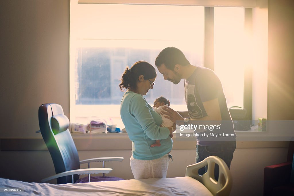 Parents with newborn at hospital : Stock Photo