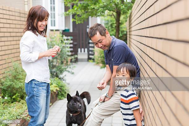 Parents with son and pet dog