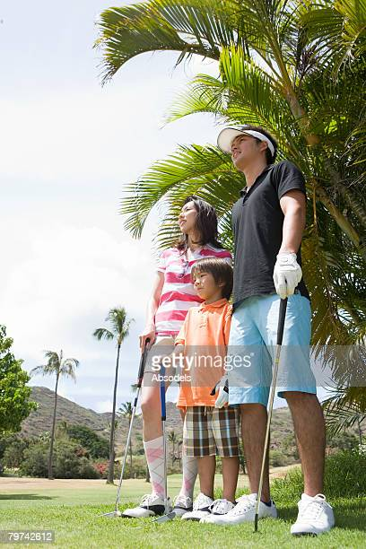 Parents with son (6-7) in golf course