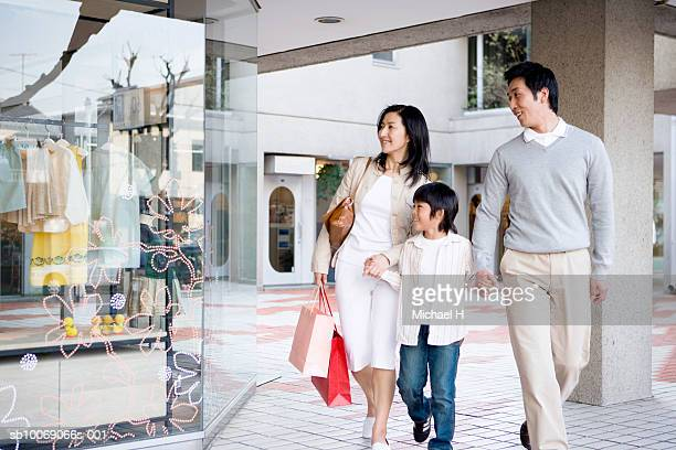Parents with son (6-7) in shopping mall
