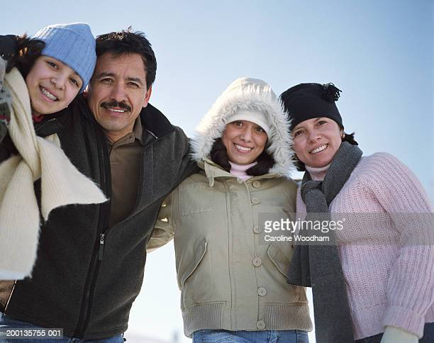 Parents with teenage daughters (12-17), outdoors, portrait