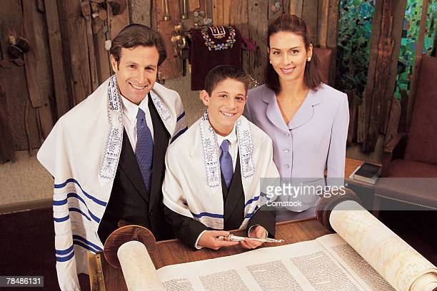 Parents with teenage son during his bar mitzvah