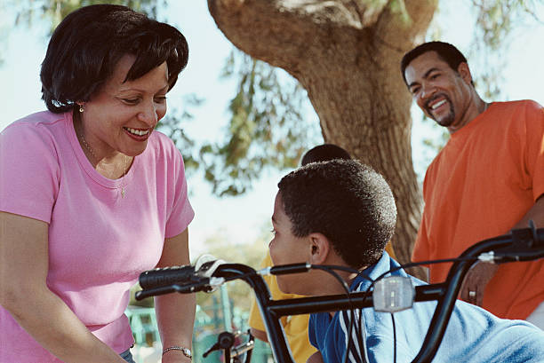 Parents with their son on bike