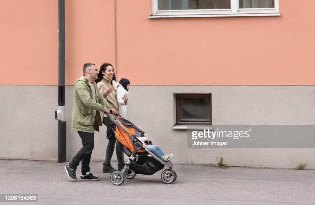 parents with two children having walk - 乳母車 ストックフォトと画像