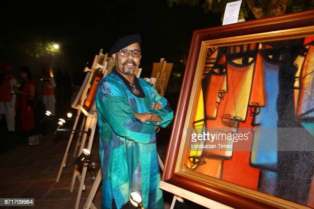 Paresh Maity with an artwork during the fundraiser for Lepra India Trust at the residence of the British High Commissioner Sir Dominic Asquith at 2...