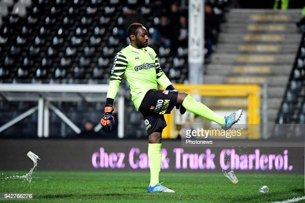 Parfait Junior Mandanda goalkeeper of Sporting Charleroi shoots at some beer cups throwing at him by RSCA supporters during the Jupiler Pro League...