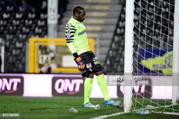 Parfait Junior Mandanda goalkeeper of Sporting Charleroi shoots on some beer cups during the Jupiler Pro League Play Off 1 match between Sporting...