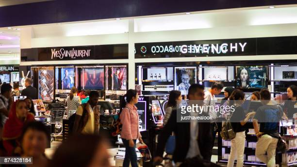 parfume and cosmetics shop in airport dubai - dubai airport stock photos and pictures