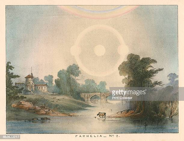 Parhelia combined with a halo and rainbow, 1721 . This phenomenon, caused by atmospheric refraction, was observed in England in 1721. From The Beauty...
