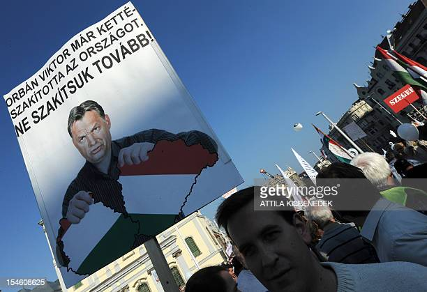 A paricipant in an antigovernment demonstration organized by a civic organization 'Onemillion citizens for the press freedom' protest with a poster...