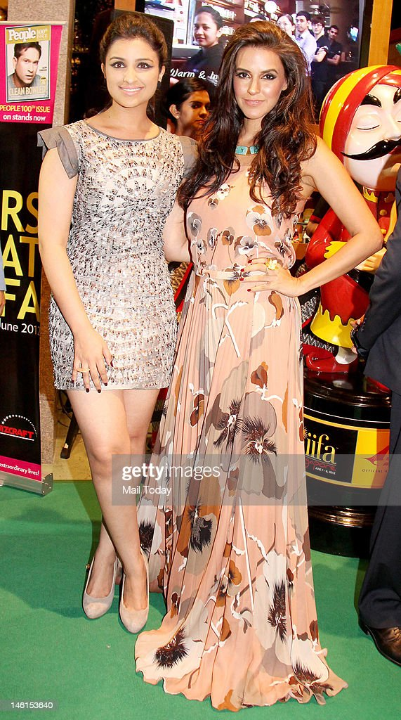 Parineeti Chopra and Neha Dhupia during the International Indian Film Academy awards ceremony in Singapore on June 8 2012 Bollywood actors are in...