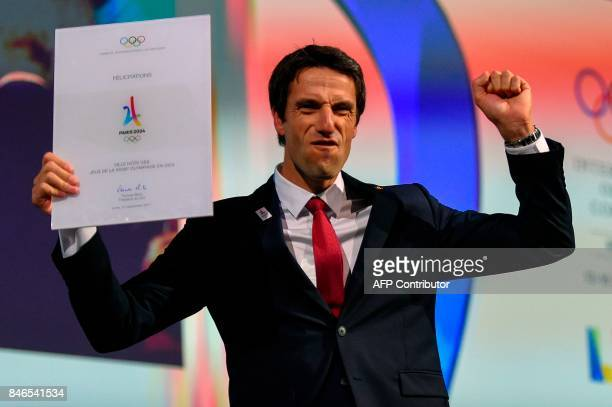 Paris 2024 bid CoChairman Tony Estanguet celebrates during the 131st International Olympic Committee session in Lima on September 13 2017 The ICO...