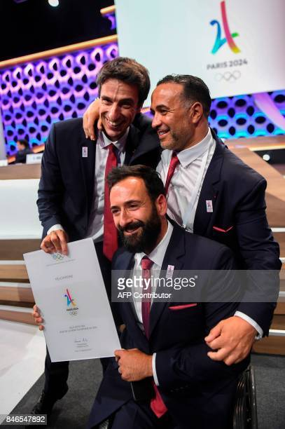 Paris 2024 bid CoChairman Tony Estanguet celebrates with other members of the delegation after Paris was awarded with the 2024 Olympic Games during...
