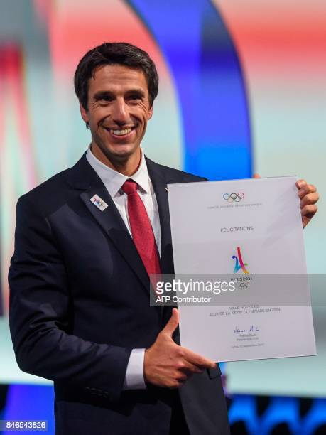 Paris 2024 bid CoChairman Tony Estanguet poses for pictures after the International Olympic Committee awarded the 2024 Olympics to Paris during the...