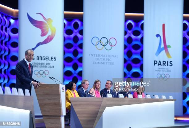 Paris 2024 bid delegation member French National Olympic Committee President Denis Masseglia speaks as the members of the Los Angeles 2028 bid listen...