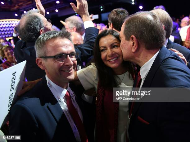 Paris 2024 bid delegation member Paris Mayor Anne Hidalgo celebrates during the 131st International Olympic Committee session in Lima on September 13...