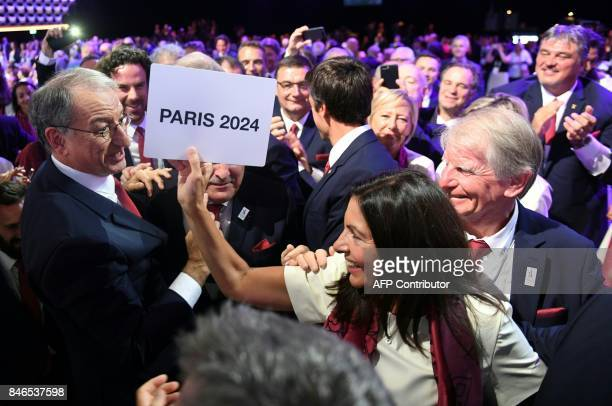 Paris 2024 bid delegation members French National Olympic Committee president Denis Masseglia and Paris Mayor Anne Hidalgo celebrate during the 131st...