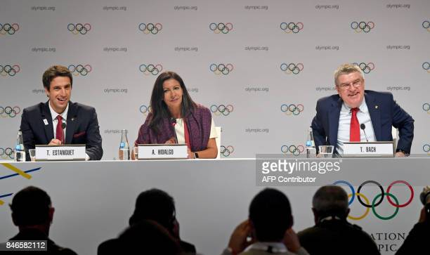Paris 2024 CoChairman Tony Estanguet Paris Mayor Anne Hidalgo and International Olympic Committee President Thomas Bach take part in a press...