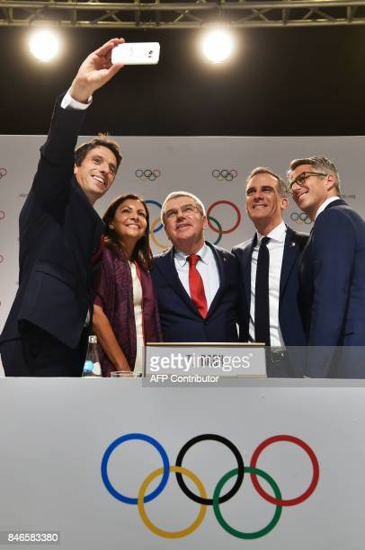 Paris 2024 CoChairman Tony Estanguet takes a selfie picture with Paris Mayor Anne Hidalgo International Olympic Committee President Thomas Bach Los...