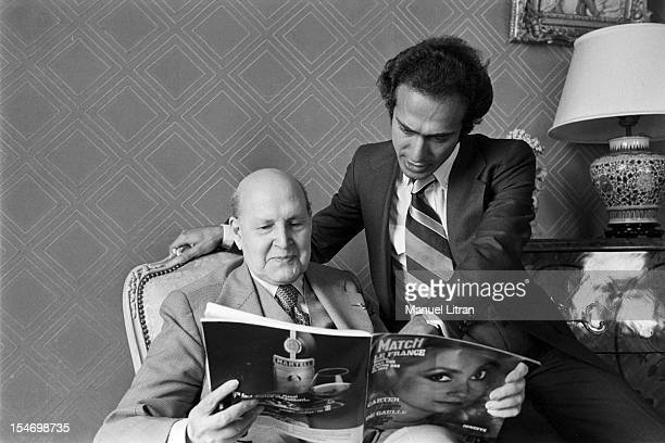 Paris 8 November 1977 Olivier Dassault grandson of Marcel Dassault poses with his grandfather who reads Paris Match