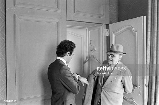 Paris 8 November 1977 Olivier Dassault grandson of Marcel Dassault poses with his grandfather putting her coat