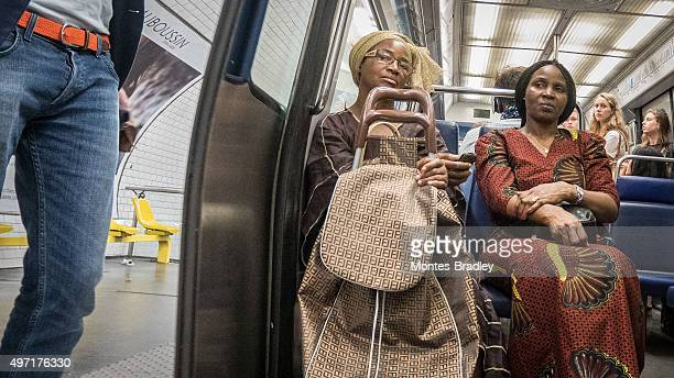 paris, a city of immigrants - migrants in paris stock photos and pictures