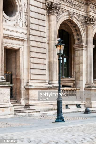 paris : a floor lamp near louvre, place du carousel - cour carree stock pictures, royalty-free photos & images