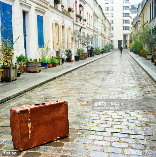 paris, a suitcase is abandoned in the street - abandoned stock pictures, royalty-free photos & images