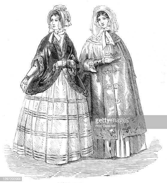 Paris and London Fashions for December, 1845. 'A dress in brown Pekin, striped in velvet. A wadded emerald satin mantle richly embroidered, with gimp...