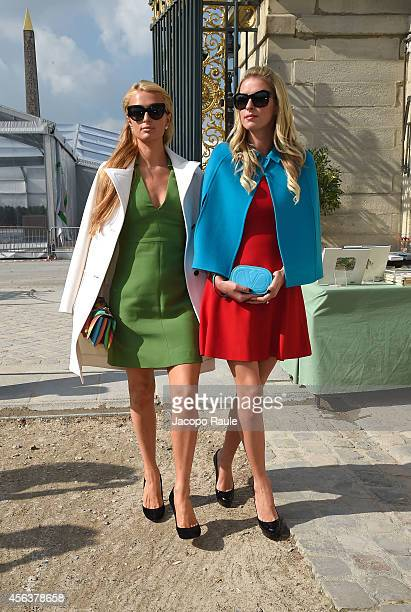 Paris and Nicky Hilton arrive at the Valentino show during Paris Fashion Week Womenswear SS 2015 on September 30 2014 in Paris France