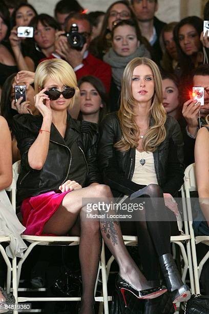 Paris and Nicky Hilton attend the Jill Stuart Fall 2009 fashion show during MercedesBenz Fashion Week in Astor Hall at the New York Public Library on...