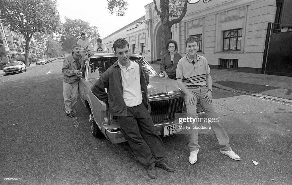 Paris Angels, group portrait, outside Maida Vale studios in London, United Kingdom, 1991. Line up includes Paul 'Wags' Wagstaff, Rikki Turner, Steven Taji, Scott Carey, Mark Adj, Jane Gill and Simon Worrall.