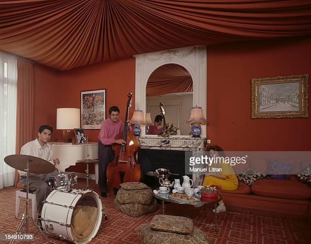 Paris, April 16 Enrico MACIAS in the music room of his Paris apartment with his wife Suzy, He improvises a song for her was the bass, his son...