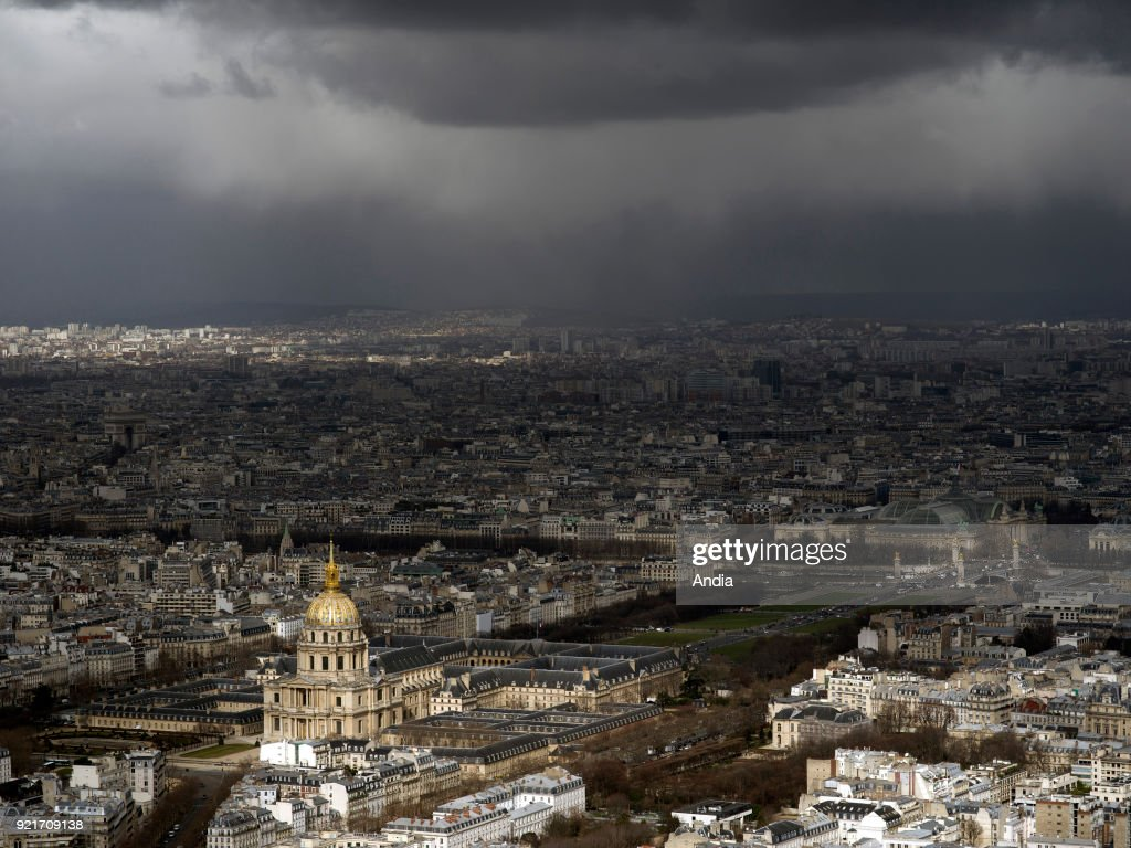 Paris (France). . April showers over the capital city. General view. Les Invalides (National Residence of the Invalids) in the foreground.