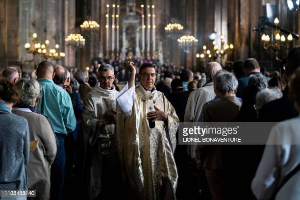 Paris' Archbishop Michel Aupetit, archbishop of Paris leads mass in tribute to the Notre-Dame de Paris Cathedral at the Saint Eustache church in...