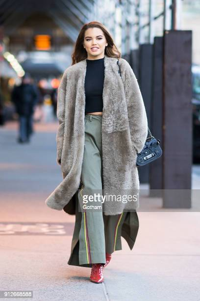 Paris Berelc is seen wearing Vince coat Helmut Lang top Tanya Taylor pants and Self Portrait shoes in Midtown on January 31 2018 in New York City