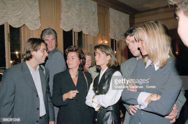 Paris Bernard Tapie's family at the premiere of the film Hommes Femmes Mode d'Emploi in which Bernard Tapie plays From left to right Stephane Tapie...