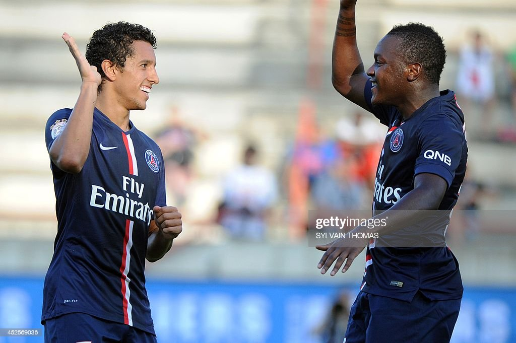 Paris' Brazilian defender Marquinhos (L) celebrates with his teammate French forward Hervin Ongenda after scoring a goal during a Ligue 1 friendly football match between Paris Saint Germain (PSG) and Nice on July 23, 2014, at the Mediterranee stadium in Beziers.