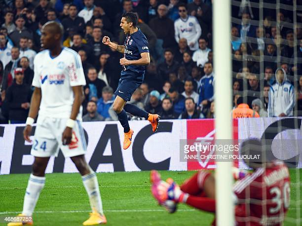 Paris' Brazilian defender Marquinhos jumps after scoring a goal during the French L1 football match Olympique de Marseille vs Paris SaintGermain on...