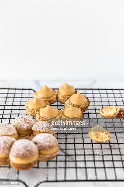 Paris Brest with caramel custard on a cooling tray