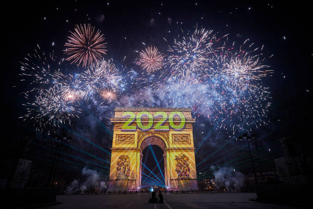 paris celebrates the new year as the arc de triomphe is engulfed in picture id